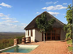 The Garamtata Lodge offers four comfortable en-suite chalets, situated on top of a ridge overlooking a waterhole